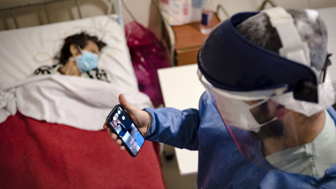 Dr Mario Grossmann holds a video call with his students of Semiology during his 24hs shift, at the emergency area of the Doctor Alberto Antranik Eurnekian Public Hospital in Ezeiza, in the outskirts of Buenos Aires.
