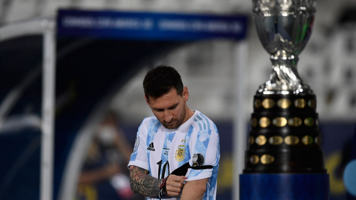 Argentina's Lionel Messi walks by Copa América trophy before the Albiceleste's clash with Chile at the Nilton Santos Stadium in Rio de Janeiro, Brazil, on June 14, 2021.